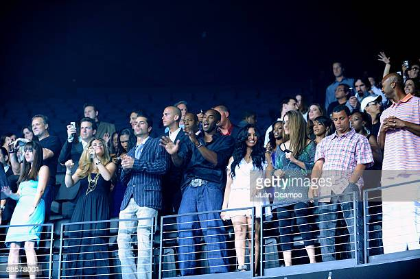 Kobe Bryant of the Los Angeles Lakers and his wife Vanessa watch Lil Wayne perform during the celebration of the 2009 NBA championship at Club Nokia...