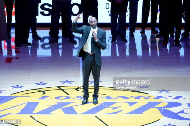 Kobe Bryant addresses the crowd at halftime as both his and Los Angeles Lakers jerseys are retired at Staples Center on December 18 2017 in Los...