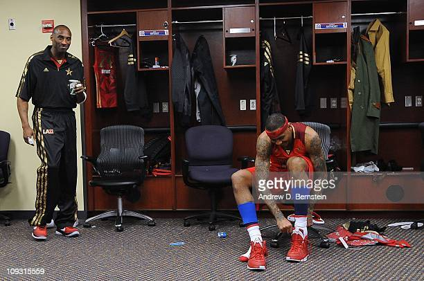 Kobe Bryant and Carmelo Anthony of the Western Conference AllStars get dressed in the locker room before their game against the Eastern Conference...