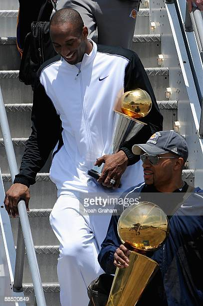 Kobe Bryant and Derek Fisher of the Los Angeles Lakers arrive at LAX on June 15 2009 in Los Angeles California after the Lakers defeated the Orlando...