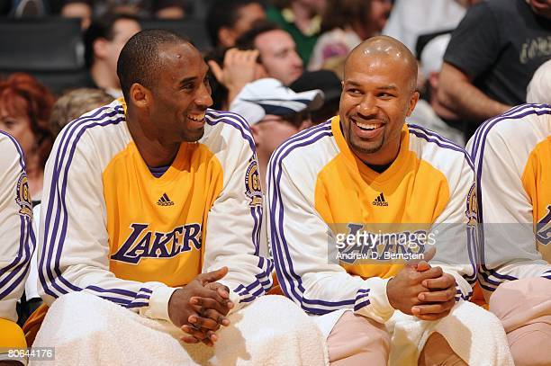 Kobe Bryant and Derek Fisher of the Los Angeles Lakers look on form the bench during the NBA game against the Seattle SuperSonics at Staples Center...