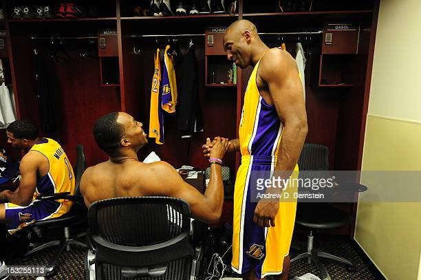 Kobe Bryant and Dwight Howard of the Los Angeles Lakers in the locker room during Media Day at Toyota Sports Center on October 1 2012 in El Segundo...