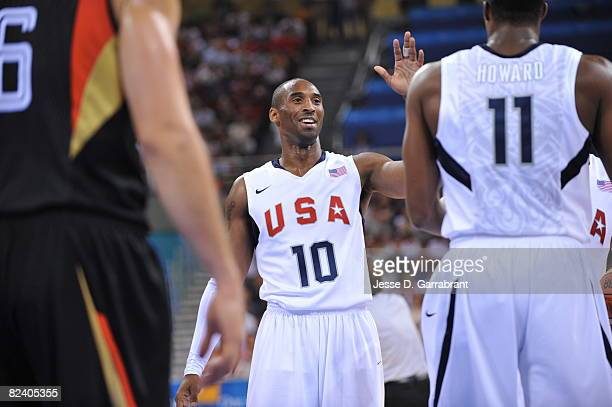 Kobe Bryant and Dwight Howard of the U.S. Men's Senior National Team celebrate against Germany during the men's group B basketball preliminaries at...