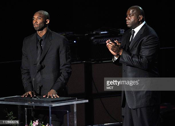 Kobe Bryant and Earvin Magic Johnson Jr speak at Michael Jackson's public memorial service at the Staples Center in Los Angeles California Tuesday...