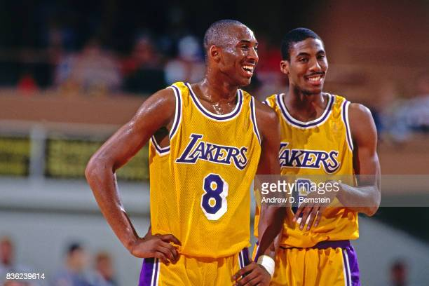 Kobe Bryant and Eddie Jones of the Los Angeles Lakers talk against the Dallas Mavericks during a preseason game on October 16 1996 at the Stan...