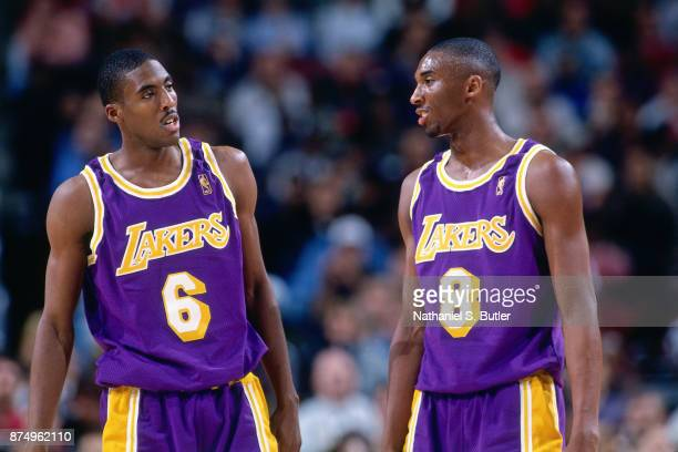 Kobe Bryant and Eddie Jones of the Los Angeles Lakers talk during a game played on November 26 1996 at the First Union Arena in Philadelphia...