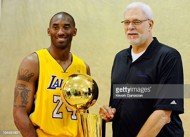 Kobe Bryant and head coach Phil Jackson of the Los Angeles Lakers pose with NBA Finals Larry O'Brien Championship Trophy during Media Day at the...