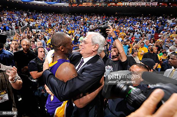Kobe Bryant and head coach Phil Jackson of the Los Angeles Lakers celebrate after the Lakers won 9986 to win the NBA Championship against the Orlando...