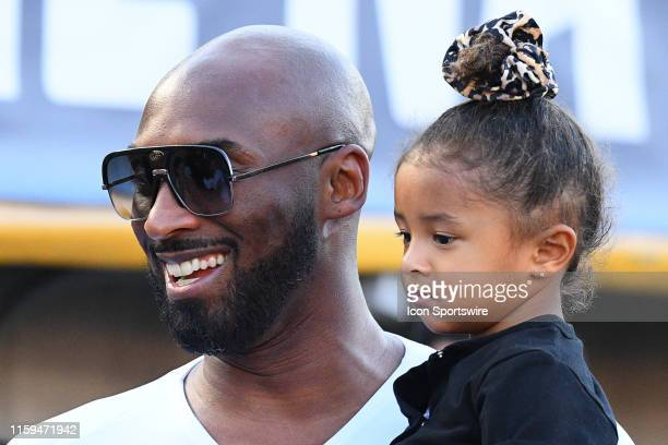 Kobe Bryant and his daughter Bianca look on during the USA Victory Tour match between the United States of America and the Republic of Ireland on...