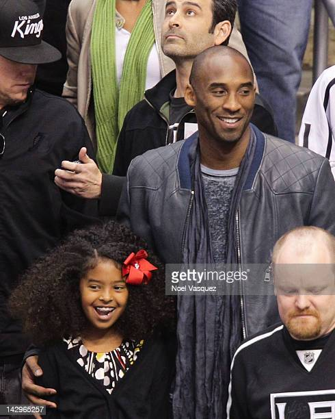 Kobe Bryant and his daughter Natalia Diamante Bryant attend a playoff hockey game between the Vancouver Canucks and the Los Angeles Kings at Staples...