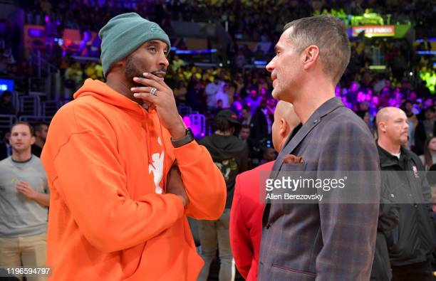 Kobe Bryant and his former agent Rob Pelinka talk prior to a basketball game between the Los Angeles Lakers and the Dallas Mavericks at Staples...