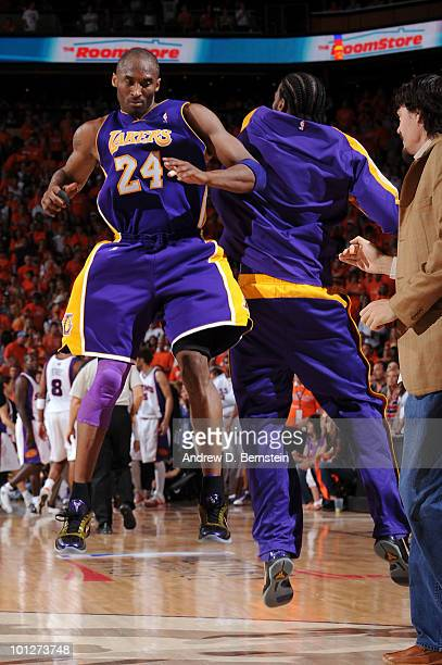 Kobe Bryant and Josh Powell of the Los Angeles Lakers celebrate during a timeout against the Phoenix Suns in Game Six of the Western Conference...