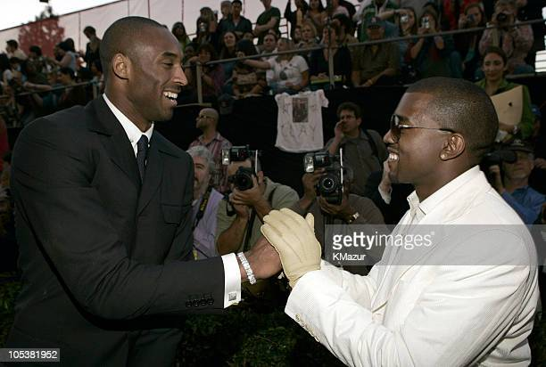 Kobe Bryant and Kanye West during 32nd Annual American Music Awards Red Carpet at Shrine Auditorium in Los Angeles California United States