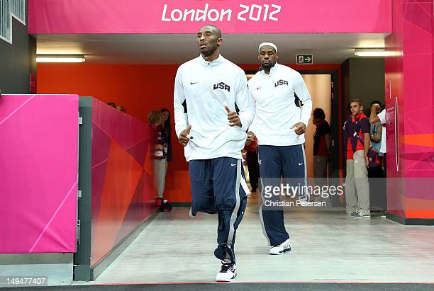 Kobe Bryant and Lebron James of United States run out from the locker room prior to their Men's Basketball Game against France on Day 2 of the London...