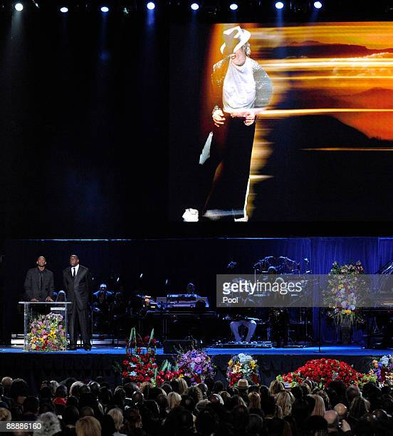 Kobe Bryant and Magic Johnson speak during at the Michael Jackson public memorial service held at Staples Center on July 7 2009 in Los Angeles...