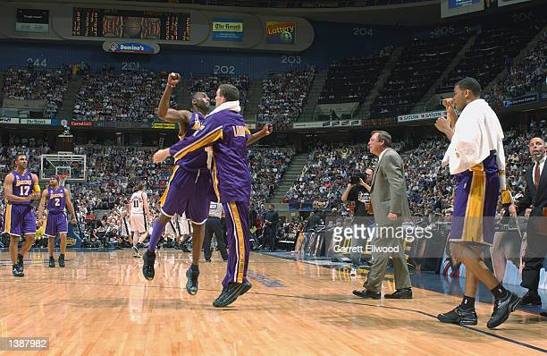 Kobe Bryant and Mark Madsen of the Los Angeles Lakers celebrate after Game four of the 2002 NBA Finals against the New Jersey Nets on June 12 2002 at...