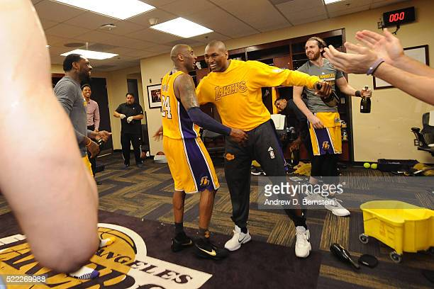 Kobe Bryant and Metta World Peace of the Los Angeles Lakers hug after the game against the Utah Jazz at STAPLES Center on April 13 2016 in Los...