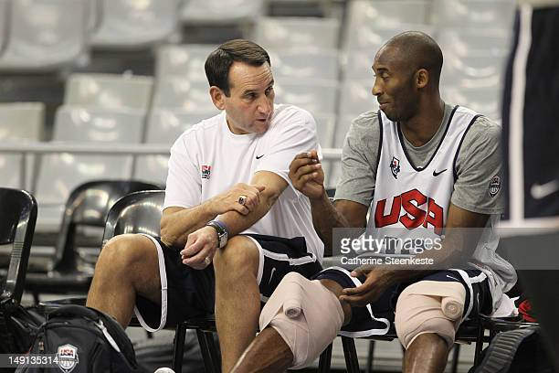 Kobe Bryant and Mike Krzyzewski Head Coach of the US Men's Senior National team are talking during practice at Palau Sant Jordi Arena on July 23 2012...