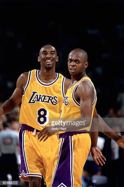 Kobe Bryant and Nick Van Exel of the Los Angeles Lakers share a light moment against the Utah Jazz during Game Four and Round 2 of the 1997 NBA...