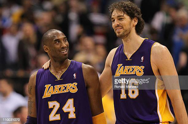Kobe Bryant and Pau Gasol of the Los Angeles Lakers react after a 96-91 win against the Dallas Mavericks at American Airlines Center on March 12,...