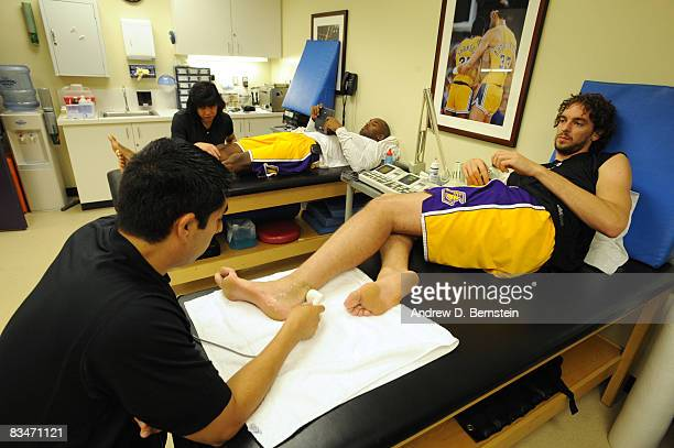 Kobe Bryant and Pau Gasol of the Los Angeles Lakers receive treatment in the training room prior to the season opener against the Portland Trail...