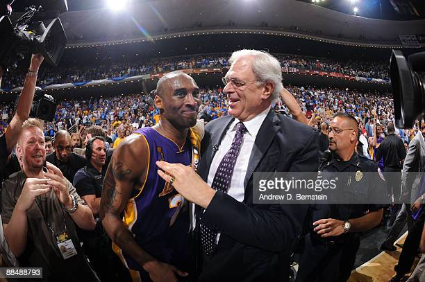Kobe Bryant and Phil Jackson, head coach of the Los Angeles Lakers celebrate after defeating the Orlando Magic in Game Five of the 2009 NBA Finals at...