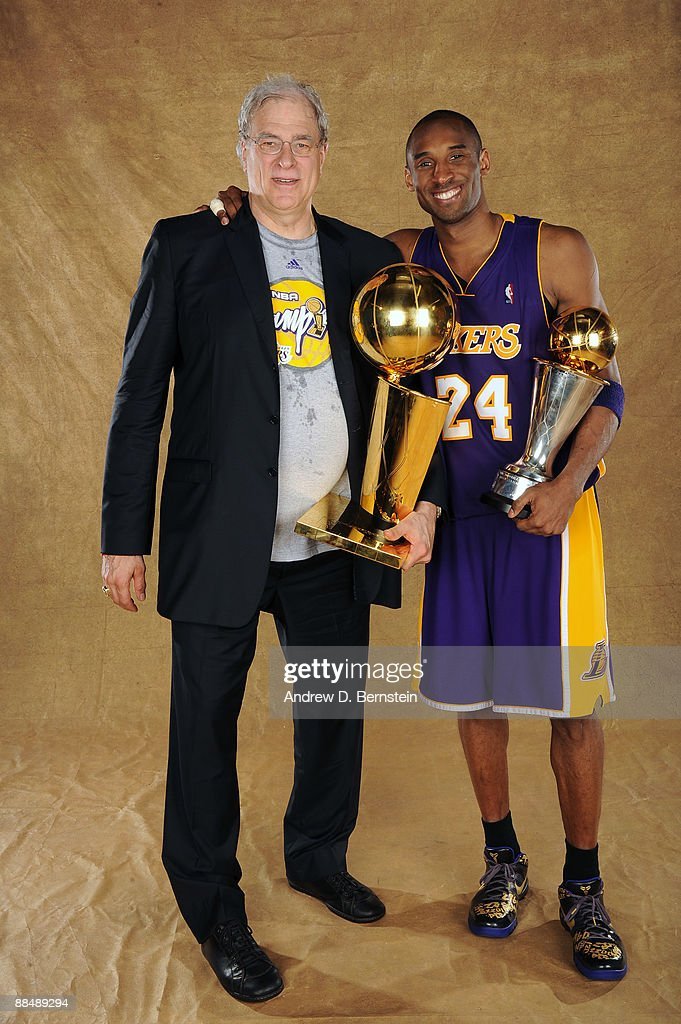 Kobe Bryant #24 and Phil Jackson of the Los Angeles Lakers pose for a portrait after defeating the Orlando Magic in Game Five of the 2009 NBA Finals at Amway Arena on June 14, 2009 in Orlando, Florida. The Los Angeles Lakers defeated the Orlando Magic 99-86.