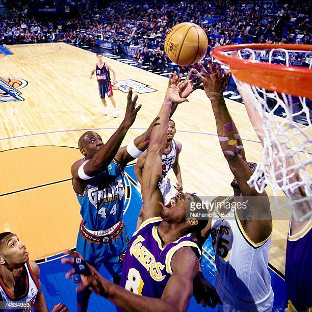 Kobe Bryant and Rodney Rogers of the Western Conference battle for a rebound against Erick Dampier of the Eastern Conference during the 1997 Rookie...