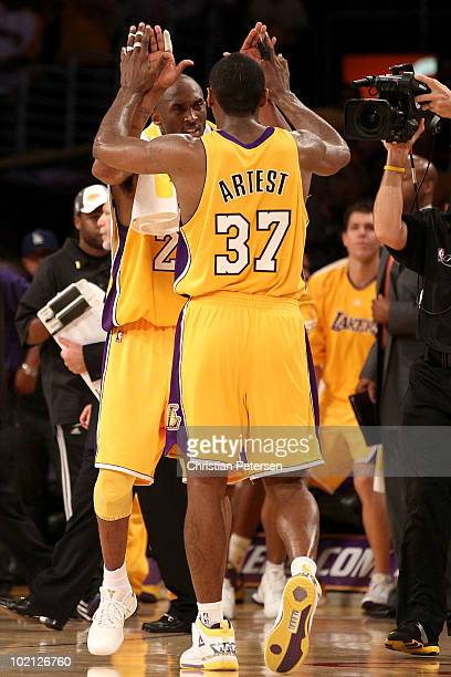 Kobe Bryant and Ron Artest of the Los Angeles Lakers celebrate in the second half against the Boston Celtics in Game Six of the 2010 NBA Finals at...