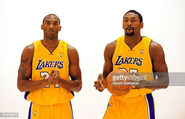 Kobe Bryant and Ron Artest of the Los Angeles Lakers pose for a photograph during Lakers media day at their training facility on September 29 2009 in...