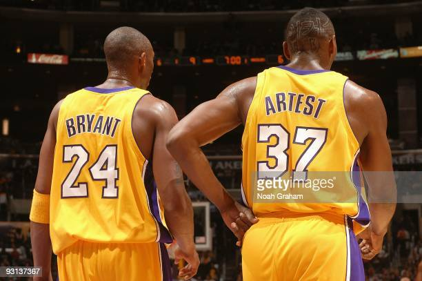 Kobe Bryant and Ron Artest of the Los Angeles Lakers stand on the court during the game against the Memphis Grizzlies on November 6, 2009 at Staples...