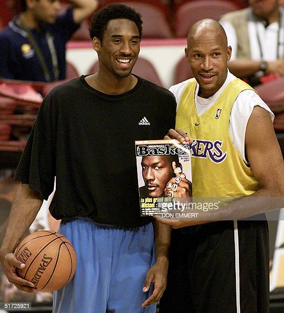 Kobe Bryant and Ron Harper of the Los Angeles Lakers show a copy of a magazine with a picture of Michael Jordan on the cover with his sixth NBA...