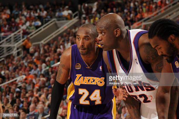 Kobe Bryant and Ronny Turiaf of the Los Angeles Lakers surround Shaquille O'Neal of the Phoenix Suns as a free throw is shot in an NBA game played at...
