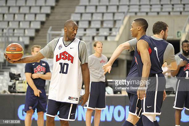 Kobe Bryant and Russell Westbrook of the US Men's Senior National team are rehearsing a play during practice at Palau Sant Jordi Arena on July 23...