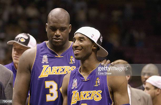 Kobe Bryant and Shaquille O'Neal of the Los Angeles Lakers celebrate after defeating the New Jersey Nets in Game four of the 2002 NBA Finals at...