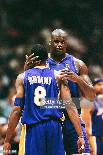 Kobe Bryant and Shaquille O'Neal of the Los Angeles Lakers during Game Three of the NBA Finals against the New Jersey Nets on June 9 2002 at...