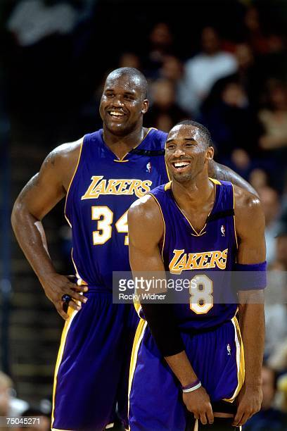 Kobe Bryant and Shaquille O'Neal of the Los Angeles Lakers have a laugh during a 2001 NBA game NOTE TO USER User expressly acknowledges that by...