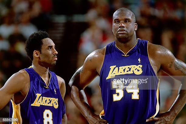 Kobe Bryant and Shaquille O'Neal of the Los Angeles Lakers look on during an NBA game circa 2001 NOTE TO USER User expressly acknowledges and agrees...