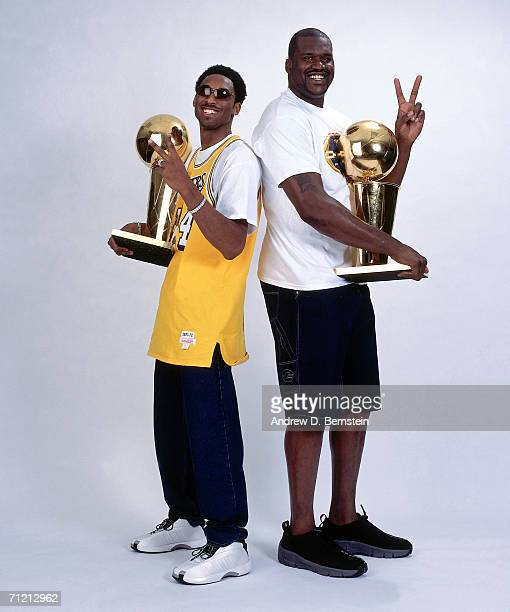 Kobe Bryant and Shaquille O'Neal of the Los Angeles Lakers pose for a portrait with two NBA Championship Trophies in 2001 in Los Angeles California...