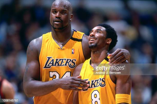 Kobe Bryant and Shaquille O'Neal of the Los Angeles Lakers walk and talk during a game played circa 2000 at the Staples Center in Los Angeles...
