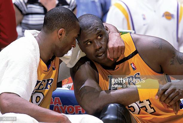 Kobe Bryant and Shaquille O'Neal of the Los Angeles Lakers watch their team from the bench in Game Six of the Western Conference Semifinals against...