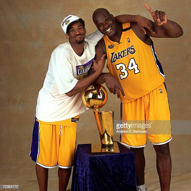 Kobe Bryant and Shaquille O''Neal#34 of the Los Angeles Lakers pose for a portrait with the Championship Trophy after defeating the Indiana Pacers in...