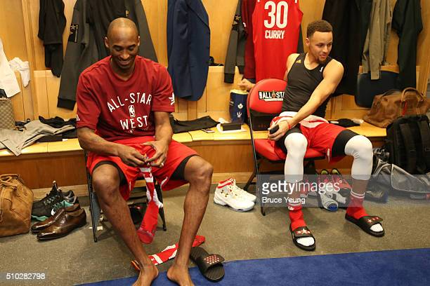 Kobe Bryant and Stephen Curry of the Western Conference AllStars sit in the locker room during the NBA AllStar Game as part of the 2016 NBA AllStar...