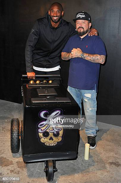 Kobe Bryant and tattoo artist Mister Cartoon pose for a picture during a Kobe AD event at MAMA Gallery on November 1 2016 in Los Angeles California