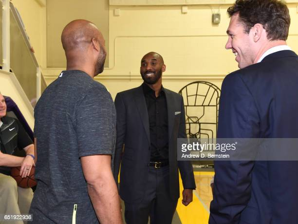 Kobe Bryant arrives at a press conference with Brian Shaw and Luke Walton announcing Rob Pelinka as the new Los Angeles Lakers General Manager at...