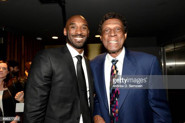 Kobe Bryant arrives at the arena greeting Elgin Baylor before his jersey retirement ceremony on December 18 2017 at STAPLES Center in Los Angeles...