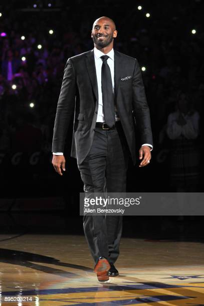 Kobe Bryant attends his jersey retirement ceremony during halftime of a basketball game between the Los Angeles Lakers and the Golden State Warriors...