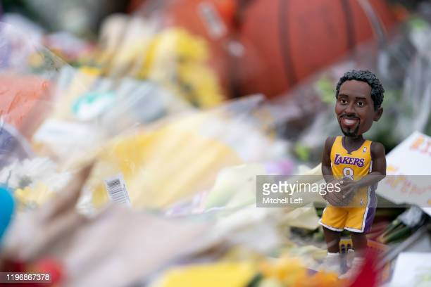 Kobe Bryant bobblehead is left at a memorial for former Los Angeles Laker Kobe Bryant after he was killed in a helicopter crash at Lower Merion High...