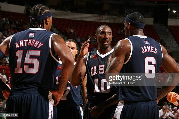 Kobe Bryant Carmelo Anthony and LeBron James of the USA Men's Senior National Team speak near the bench during their game against Puerto Rico in the...