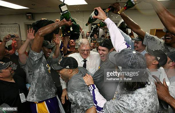 Kobe Bryant Derek FIsher head coach Phil Jackson and Luke Walton of the Los Angeles Lakers celebrate in the locker room with their teammates after...